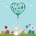 Easter decoration rabbit holding happy easter balloon Royalty Free Stock Image