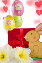 Easter decoration with rabbit narcissus and eggs over white Royalty Free Stock Images