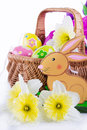 Easter decoration with rabbit narcissus and eggs over white Stock Photo