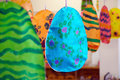 Easter decorations painted on egg paper shapes by children and hanging in kindergarten Royalty Free Stock Photo