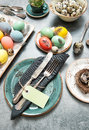 Easter dinner table decoration with colored eggs Royalty Free Stock Photo