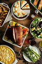 Easter dinner table with ham, asparagus and cake Royalty Free Stock Photo