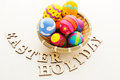 Easter egg in basket with wooden text Royalty Free Stock Images