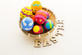 Easter egg in basket with wooden text close up Stock Image