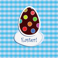 Easter egg on blue  checkered backgr Royalty Free Stock Images