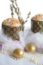Easter egg cake fluff gold composition of golden eggs feathers beads pussy willow and rose petals Stock Images