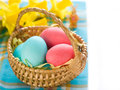 Easter egg colored in basket selective focus Royalty Free Stock Image