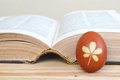 Easter egg colored naturally and old book Royalty Free Stock Photo
