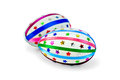 Easter egg with colored ribbons and sequins two eggs decorated multicolored braid sparkles in the form of stars a light shade on Royalty Free Stock Photo