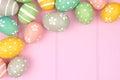 Easter egg corner border against pink wood Royalty Free Stock Photo