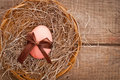 Easter egg decorated with ribbon on wooden background Royalty Free Stock Images