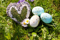 Easter egg decoration outdoor in spring green gras Stock Images