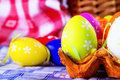 Easter egg eggs arranged with a tablecloth and paper packing for eggs Royalty Free Stock Photos