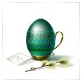 Easter egg with green ornament and sprig of willow beautiful geometric on vintage metal stand handle Royalty Free Stock Photography