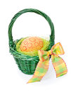 Easter egg in a green straw basket on white Royalty Free Stock Photography