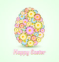Easter egg made of flowers isolated on light green background Royalty Free Stock Photos