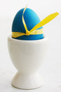 Easter egg painted blue is on stand Stock Photos
