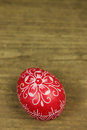 Easter egg red decorated on wooden background Stock Photos