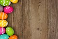 Easter egg side border against rustic wood Royalty Free Stock Photo