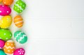 Easter egg side border against white wood Royalty Free Stock Photo