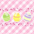 Easter egg and spring flowers on pink gingham Royalty Free Stock Image