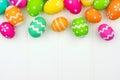 Easter egg top border against white wood Royalty Free Stock Photo