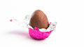 Easter egg unwrapped pink foil white background Royalty Free Stock Images