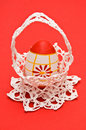 Easter egg in white crochet basket Royalty Free Stock Images