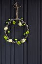 Easter egg wreath on a wooden background Royalty Free Stock Image