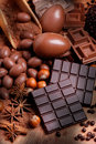 Easter eggs and assorted chocolate on wooden table Stock Photography