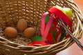 Easter eggs in a basket with a braided whip.