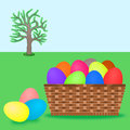 Easter eggs a basket containing colorful for egg hunt on a field Royalty Free Stock Photos