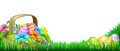 Easter eggs basket frame scene footer design full of decorated chocolate and flowers in a field Stock Photography