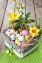 Easter eggs in the basket on green striped cloth Royalty Free Stock Photo