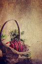 Easter eggs in basket with grunge texture Stock Photo