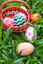 Easter eggs in the basket with painted garden Stock Photo
