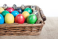 Easter eggs in the basket painted and quail on sackcloth on white background Royalty Free Stock Photography