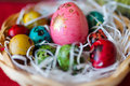 Easter eggs basket on table Stock Photography