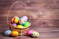 Easter eggs in the basket of wooden boards Royalty Free Stock Photos