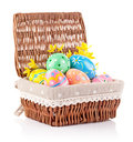 Easter eggs in basket with yellow flowers Royalty Free Stock Photo