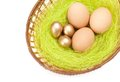 Easter eggs are in braided basket Royalty Free Stock Image