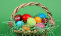 Easter eggs in the bucket with green background Stock Photography