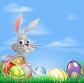 Easter eggs bunny in field white rabbit with a basket of chocolate Royalty Free Stock Photos