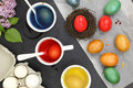 Easter eggs colored and liquid color dyes Royalty Free Stock Photography