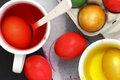 Easter eggs colored and liquid color dyes Stock Images