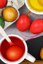 Easter eggs colored and liquid color dyes Royalty Free Stock Photos