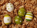Easter eggs colored on wood shavings Royalty Free Stock Image