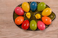 Easter eggs colorful on a green ceramic plate Royalty Free Stock Photo