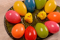 Easter eggs colorful on a green ceramic plate Royalty Free Stock Image