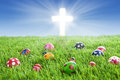 Easter eggs and Cross on grass Stock Photos